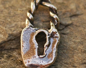 One Rustic Handcrafted Tiny Lock Charm in Sterling Silver