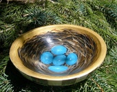 Wooden bowl with robin's nest and black and white checks