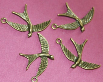 10 pcs of antiqued Brass finished bird drops 22x32mm