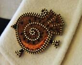 A sweet little woolly robin brooch