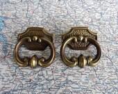 SALE! 2 vintage round open brass metal pull handles w/ att. trimplates