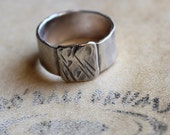 Mens ring of rugged sterling silver