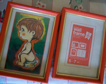 two red wooden frames
