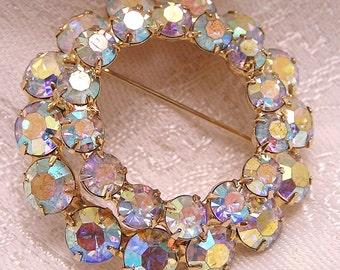 Vintage Aurora Borealis Circle Brooch. (J52)