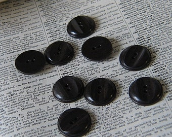 Nine Vintage Black Plastic Buttons