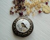 Little Bird Locket in Gold with Garnets 30 in--  Queen Louise Locket