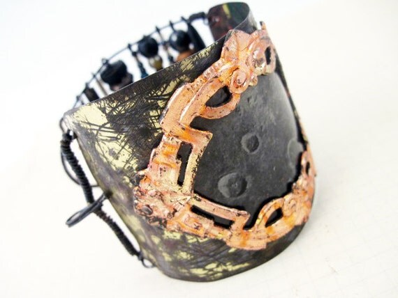 Join the Call. Salvaged tin cuff with gold leafed frame, resin paper moon, dark rustic beads.