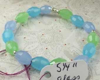 Glass Oval faceted beads on bracelet made with stretchy cord in multi colors