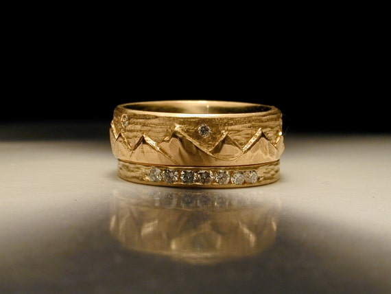 Carved mountains and diamond wedding ring.