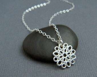 small silver necklace. silver flower necklace. sterling silver. simple. modern oval filigree. delicate. everyday. dainty jewelry 1/2""
