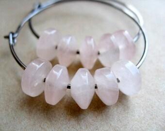 rose quartz earrings. hoop earrings in niobium. pastel pink jewelry.