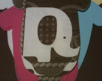 Any quantity baby shower shirt shaped or bib shaped paper napkins. Brown and white elephants with contrasting solids.