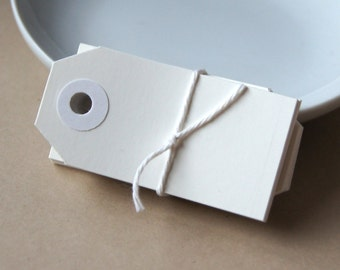 25 Mini Manilla Parcel Shipping Tags in White . Size 1 (2 3/4 x 1 3/8)