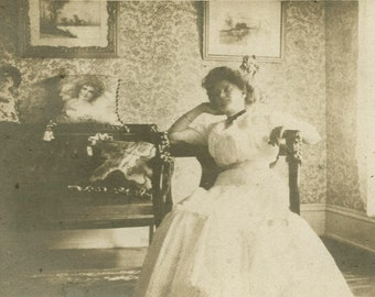 Woman Daydreaming in Parlour Interior Cabinet Photograph