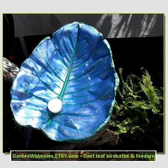 A Parrish blue Philodendron leaf cast into a birdbath/feeder on a pole (Leaf no. 1412)
