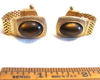 Pair of Cufflinks with brown stones, mesh gold tone, by Swank