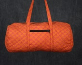 Quilted Duffle bag in Multi Colored Polka Dots Print.