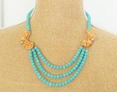 SALE Turquoise and Tangerine Statement Necklace - Triple Strand Turquoise Howlite Beads Vintage Orange Enamel Pearl Flower Wedding Bridal