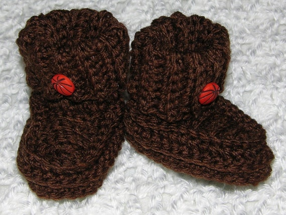 Brown booties with orange basket ball button