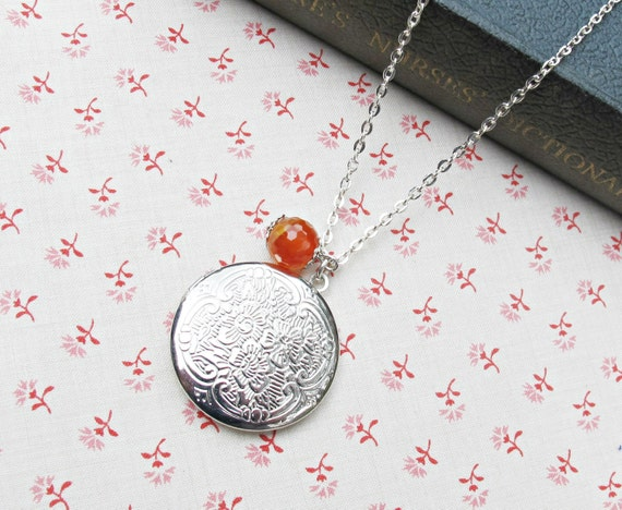 image mr darcy locket necklace jane austen pride and prejudice silver two cheeky monkeys orange carnelian