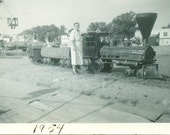 1954 Paul Bunyan Playground Grandma Standing Next To Train Armory Building Vintage Black and White Photo Photograph