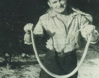SNAKE Man Standing Holding a Long Caught Wild Snake Vintage Black and White Photo Photograph