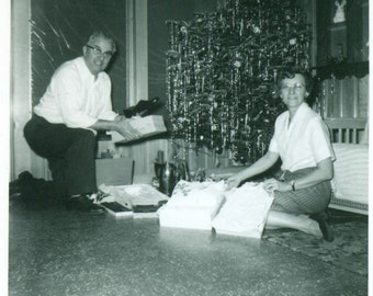 Christmas Morning Grandparents Sitting Under Tree With Gifts Shoes Coffee Pot  1950s Vintage Black White Photo Photograph