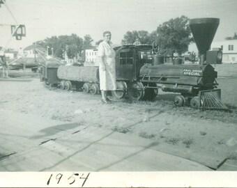 1954 Paul Bunyan Playground Grandma Standing Next To Train Armory Building Vintage Black and White Photo Photograph