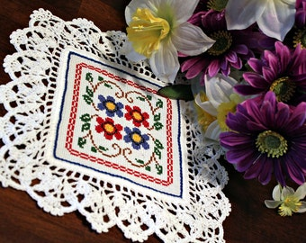 Four Flower  cross stitched doily