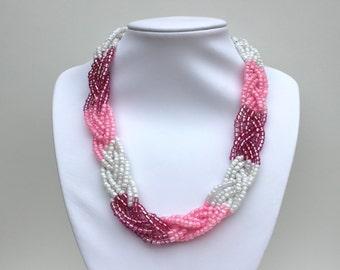 Shades of pink braided bib statement necklace.