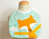 woodland baby bib with fox in cotton fabric with waterproof fabric on reverse - in turquoise & orange