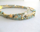 Seet of three bohemian inspired teal turquoise friendship bracelet.
