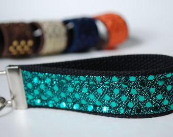 Key fob sparkle sequin fabric wristlet in teal blue color