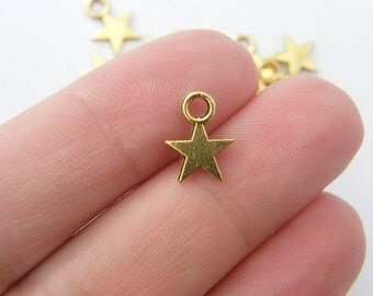 18 Star charms antique gold tone S13