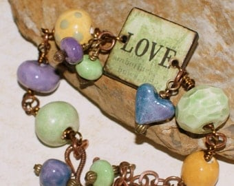 Handmade clay bead bracelet with copper, decoupaged tile