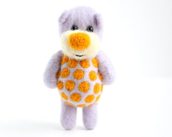 Felted pastel violet pocket bear with orange polka dots