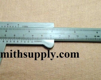 Caliper measure in inches and in millimeters 7 inch plastic beading tool T022