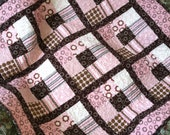 Baby girl quilt in pink and brown cotton flannel.