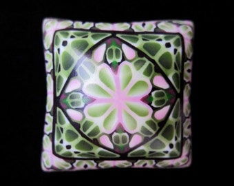 Polymer clay pillow bead by Meg Newberg