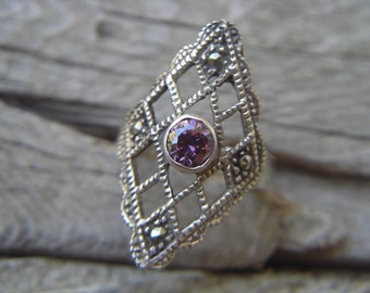 Vintage marcasite ring with a purple cz in the center