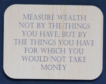 "Magnet says ""Measure wealth not by the things you have..."", laser engraved, custom color"