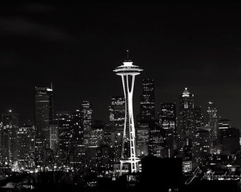 space needle photo, black and white photography, seattle at night, twinkling romantic lights, city landscape