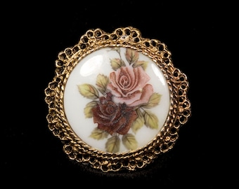 Porcelain Pin Brooch Oval cameo picture brooch Round shape Two roses and leaves White background Gold Bezel Vintage