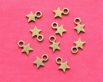 10 small STAR Charms, antique bronze tone, UK Seller