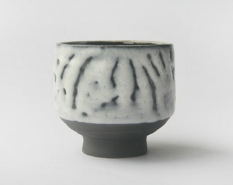 Yunomi teacup - white shino glaze over black slip