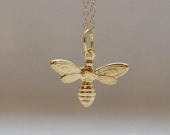 Tiny bee necklace in gold