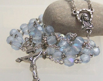 Catholic rosary handmade with ice blue faceted glass beads in silver