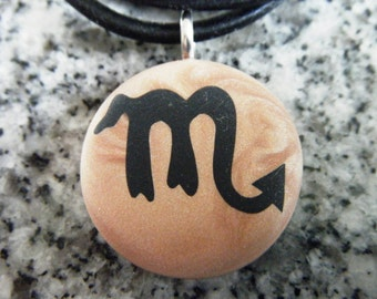 Zodiac SCORPIO signs hand carved on a polymer clay Copper pearl background. Pendant comes with a FREE 3mm necklace.
