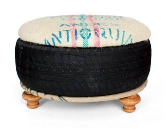 Foot Stool ottoman from saved landfill tire padded top with coffee sack and turned stool feet