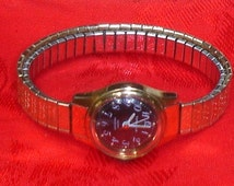 Vintage Charcoal Face Water Resistant N8 Bulova Caravelle Ladies Watch with Caravelle 10K Top & Stainless Stretch Flex Band